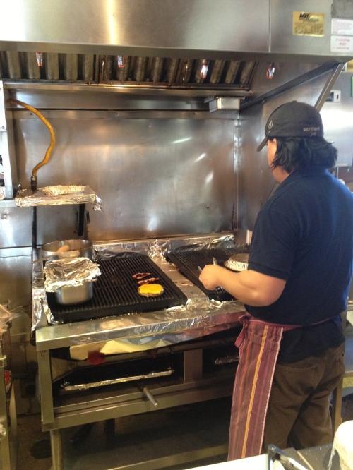 Cheeseburger being prepared